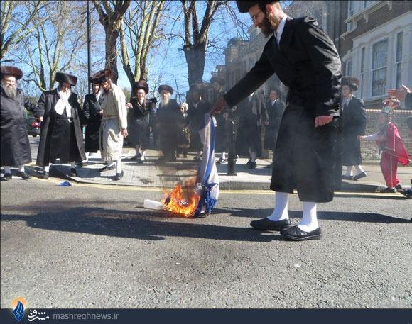 تصاویر|آتش زدن پرچم اسرائیل توسط یهودیان