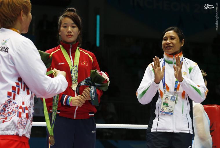 بوکسور زنهندی مدالش را نگرفت و به گردن زن کره ای انداخت +تصاویر