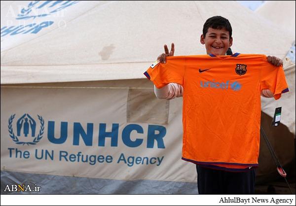 کمک تیم بارسلونا به آوارگان عراق+تصاویر